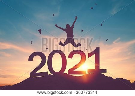 Silhouette Man Jumping And Birds Flying On Sunset Sky At Top Of Mountain And Number 2021 Abstract Ba