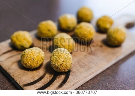 Plant-based Food, Vegan Homemade Chickpea Falafel Balls On Cutting Board Ready To Be Fried