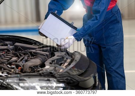 Car Mechanic Is Changing Car Battery, Male Engineer Is Changing Car Battery Because Car Battery Is D