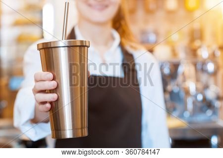 Closeup Female Hands Are Holding Stainless Metal Reusable Tumbler Cup Mug With Drinking Straw. Baris
