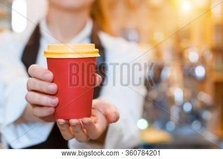 Closeup Female Hands Are Holding Paper Disposable Cup Of Coffee. Barista Woman  Prepared, Brewed Esp