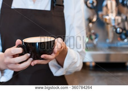 Closeup Female Hands Are Holding Cup Of Aromatic Coffee. Barista Woman Prepared, Brewed Espresso, Am