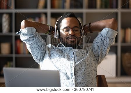 Peaceful Young African American Businessman Relaxing Listening To Classis Music.