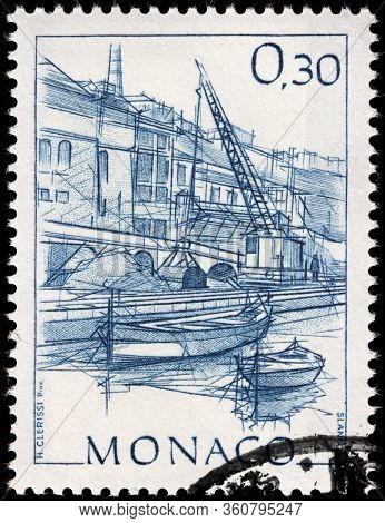 Luga, Russia - April 10, 2020: A Stamp Printed By Monaco Shows View Of Monte Carlo Commercial Harbou