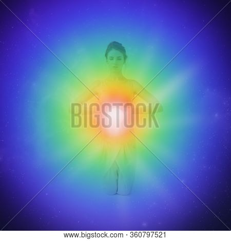 Woman Meditating. Colored Chakra Lights Over Her Body. Yoga, Zen, Buddhism, Recovery And Wellbeing C
