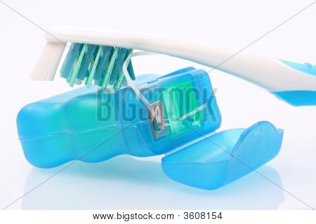 Dental Floss And Toothbrush
