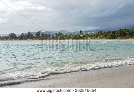 Seashore Along Bay And Mountains Behind Clouds On Horizon Of Northeast Coast In Puerto Rico
