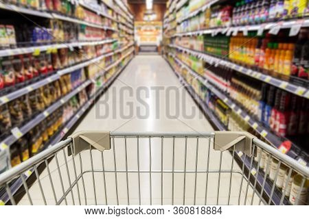 Shopping Cart In Empty Supermarket Store During Covid-19 Quarantien.