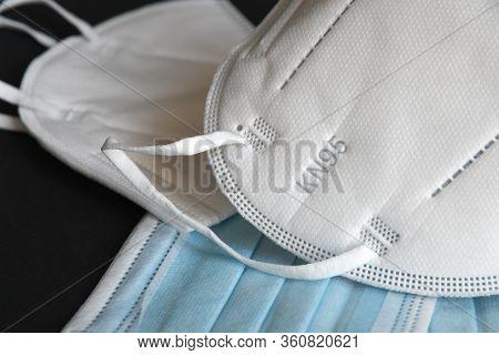 White Kn95 Or N95 Mask With Antiviral Medical Mask For Protection Against Coronavirus On Black Backg