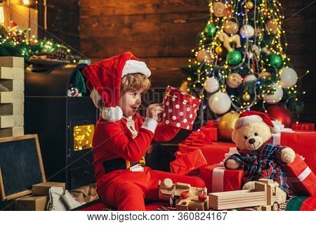 Happy Child With Christmas Gift. New Year Kids. Cheerful Cute Child Opening A Christmas Present. Chr