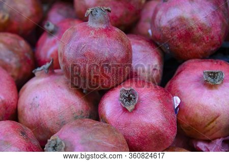 Red Pomegranate Fruit. On Sale In A Vegetable Shop.