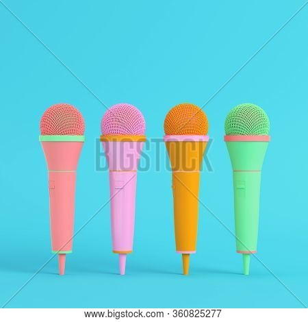 Four Colorful Microphones On Bright Blue Background In Pastel Colors. Minimalism Concept. 3d Render