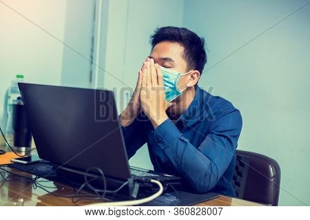 Businessman Working With Laptop. He Wearing A Mask And Coughing In Office.
