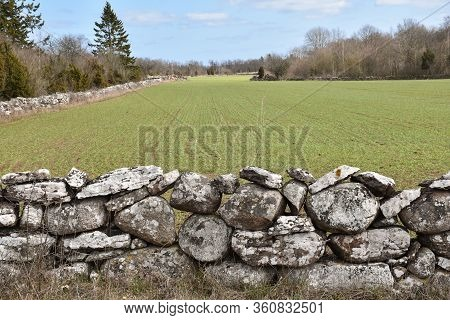 Dry Stone Wall By A Farmers Field In Spring Season