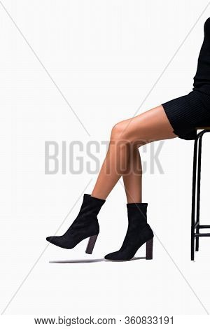 Black Hessian Boots Suede On The Feet Of A Model On A White Background With Shadows. Jackboots. Stud