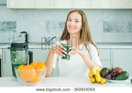 Woman Drinking Matcha From Glass At Home. Food Supplements, And Spirulina. Healthy Eating Concept. M