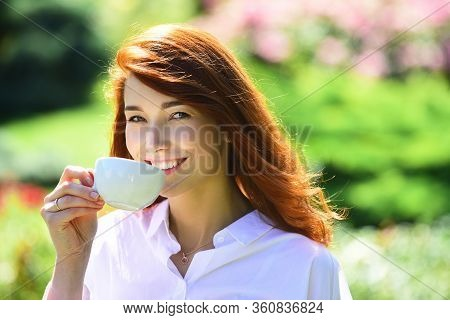 Girl Drinking Coffe. Young Woman Having Break, Holding Cup And Drink Coffe