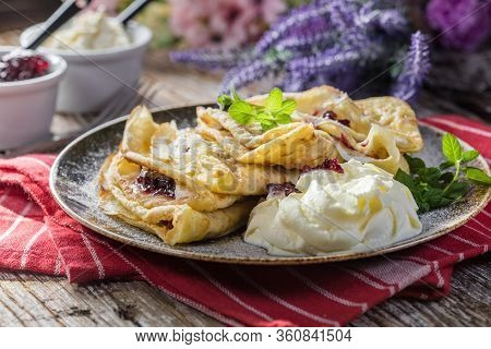 Crepes With Ricotta Cheese And Blackcurrant Jam. Delicious Crepes, Thin Pancakes.