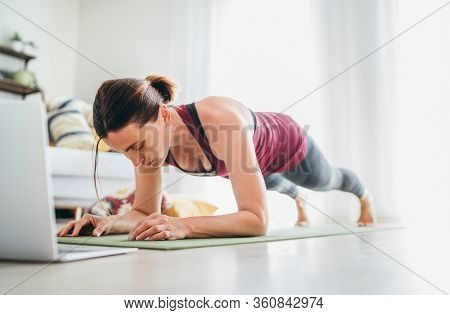 Fit Sporty Healthy Woman On Mat In Low Plank Chaturanga Dandasana Yoga Pose, Doing Breathing Exercis