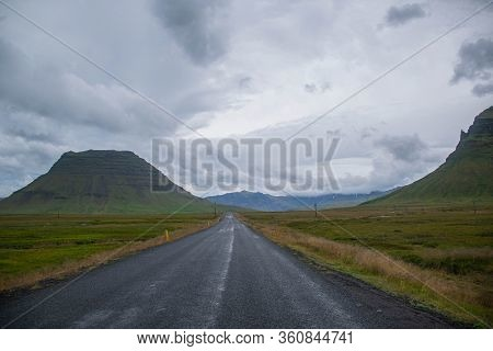 Long Road Between Mountains In The Middle Of Nothing
