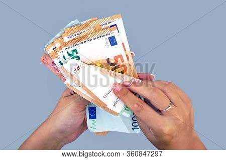 Woman Hands That Consider 100, 50-euro Bills. In The Hands Of A Lot Of Money, Denominations Of Euros