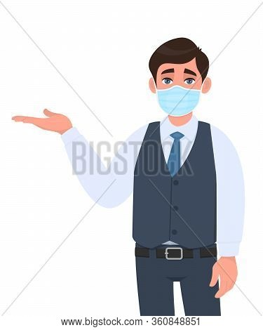 Young Businessman Wearing Medical Mask And Presenting Hand To Copy Space. Person In Waistcoat Coveri