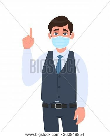 Young Business Man Wearing Medical Mask And Pointing Finger Up. Trendy Person In Waistcoat Covering