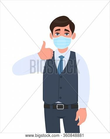 Young Businessman Wearing Medical Mask And Showing Thumbs Up Sign. Trendy Person In Waistcoat Coveri