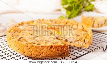 Homemade Freshly Tasty French Quiche Lorraine Tart Pie With Chicken Meat And Mushrooms.