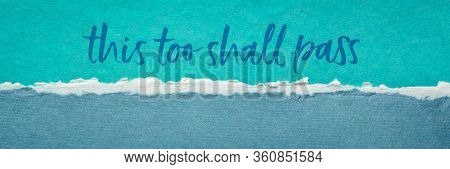 this too shall pass - inspirational handwriting on a handmade paper, positivity, hope, temporary nature, or ephemerality of the human condition and situation