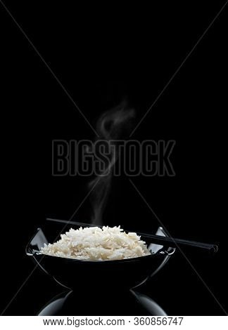 Boiled Basmati Rice On A Black Background. Asian Tradition. Studio Shooting.