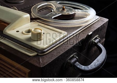 A Part Of Vintage Reel Tape Recorder From 1960s On A Black Background. Selective Focus.