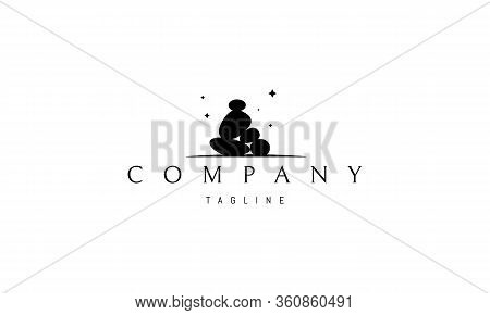 Vector Logo On Which An Abstract Image Of A Pile Of Cobblestones In The Form Of A Meditator.