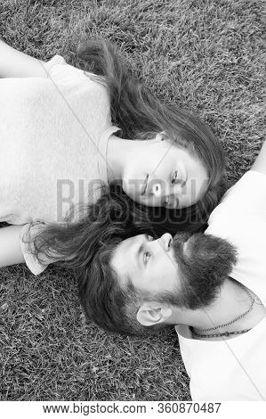 Freshness And Peace. Hipster Bearded Man And Girl Happy Carefree Enjoy Spring Nature Top View. Relax