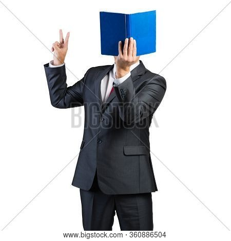 Businessman Covered His Face With Book And Finger Pointing Up. Portrait Of Man In Business Suit And