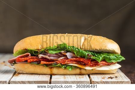 Salami Sandwich On Baguette With Linen Backdrop