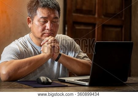 Christian Men Praying And Working At Home With Laptops.