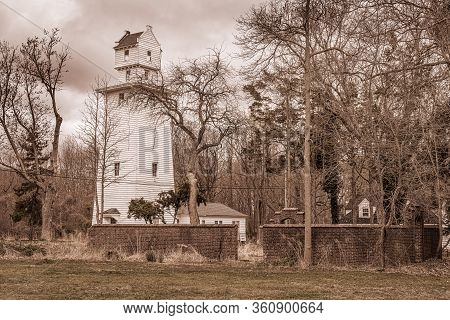 A Sepia Toned View Of The Historic Stucile Farm Water Tower In Joe Palaia Park In Ocean New Jersey.