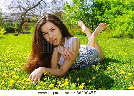 Beautiful Girl In A Summer Garden