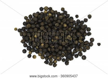 Organic Raw Grain Black Pepper Heap On White Background In Top View Macro. Black Pepper Is Herb And