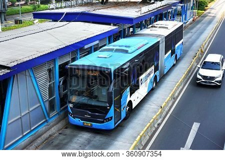 Jakarta, Indonesia  - July 7, 2019 ; Bus Rapid Trasit (brt) Arrived At Bus Shelter Gelora Bung Karno