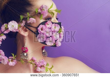 Girl With Gorgeous Long Hair In An Antiviral Mask. Fashion Photo On The Cover Of The Magazine. Pande