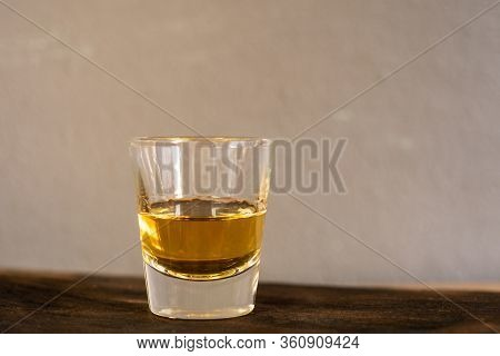 Whiskey One Shot In A Cup Oo Wood Table.