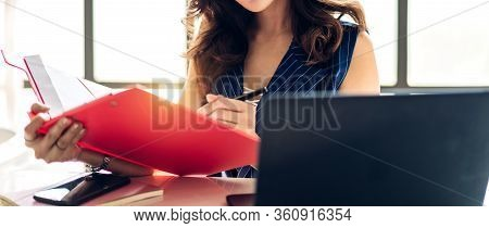 Beautiful Confident Asian Businesswoman Relaxing Looking At Technology Of Laptop Computer While Sitt