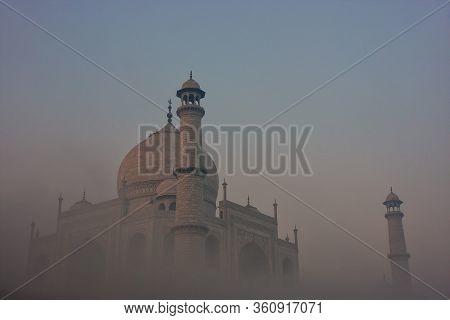 View Of Taj Mahal In Early Morning Fog, Agra, Uttar Pradesh, India. Taj Mahal Was Designated As A Un