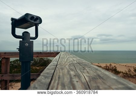 Binoculars For The Observation Deck On The Beach At The Wooden Railing