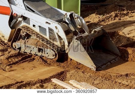 Mini Bulldozer With Earth Doing Landscaping Works Level The Ground