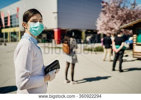 Shopper With Mask Standing In Line  To Buy Groceries Due To Coronavirus Pandemic In Grocery Store.co
