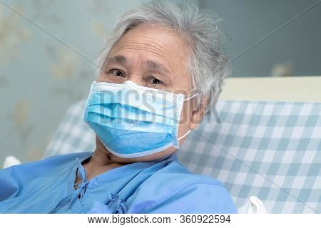 Asian Senior Or Elderly Old Lady Woman Patient Wearing A Face Mask To Protect Coronavirus And While