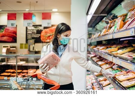 Shopper With Mask Safely Buying For Groceries Due To Coronavirus Pandemic In Grocery Store.covid-19